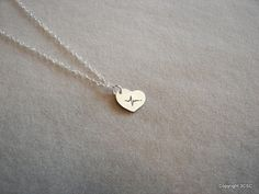 "Idea for graduation present- necklace like this but with proper NSR and ""RN"" engraved on the back."