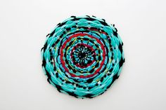 Add some color to your tabletop with this woven circular placemat. Make Your Own Clay, Circular Weaving, Diy Notebook, Fabric Yarn, Weaving Projects, Woven Wall Hanging, Yarn Crafts, Rope Crafts, Preschool Crafts