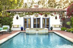 The tiles on a raised Jacuzzi create a focal point at the end of the pool. French doors open to the poolhouse.
