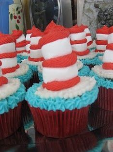 Make these fun Seuss hat cupcakes! use red frosting and marshmallows to create!