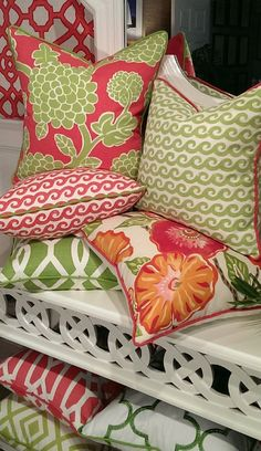 Beautiful assortment of tropical pillows emphasizing the famous Palm Beach Green, with pink, orange and white.