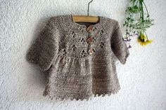 "Little Ancolie, by Nadia Crétin-Léchenne:  lace lady from my book ""baby"" , knitted merino MADELINETOSH light colors antique lace , about 60g for size 3 months - 3.5mm needles, Fr.5.00 CHF, about $5.49"