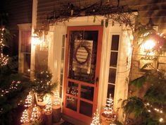 primitive porches | On the garage I tied up my old sleigh to an iron trellis that is ...