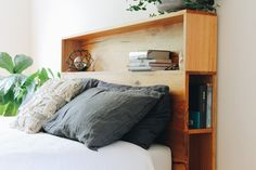 Platform bed with Bookshelf bedhead - Featuring the popular bookshelves but elevated on top of a platform base. Custom made from locally sourced, recycled hardwood timbers. A unique forever bed handmade on the Surf Coast of Victoria, Australia. Timber Bed Frames, Timber Beds, Timber Bedhead, Headboard With Shelves, Bed With Shelves, Bed With Bookshelves, Bed Headboard Storage, Bed Linen Australia, Bedroom Decor