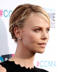 "See the ""Charlize Theron's Braided Bun"" in our Celebrity Hairstyles to Inspire Your Wedding Look (And How to Actually Do Them!) gallery"