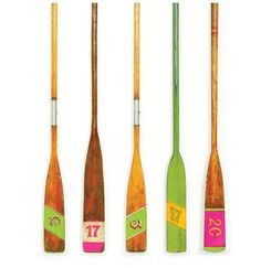 Vintage oars make great decor accents along with vintage tennis rackets and croquet sets