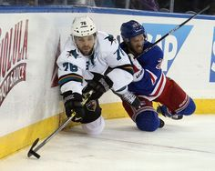 San Jose Sharks forward Eriah Hayes looks to make a play with the puck from ice level (Oct. 19, 2014).