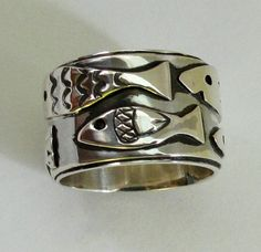 20% off Sterling Silver Swimming Fish Ring by gailheftimetalsmith on Etsy