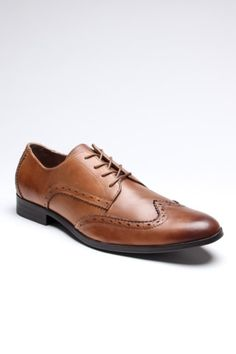 These shoes just look old. They are definitely from the past, but they are an awkward brown color. I could see Tom wearing these because he could wear them to work or when he goes out. They look comfortable and easy to get around in, too.