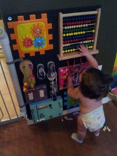 Thank you grandpa for my amazing busy board! Thank you grandpa for my amazing busy board! Sensory Wall, Sensory Boards, Baby Sensory Board, Infant Activities, Activities For Kids, Toddler Play, Toddler Shoes, Toddler Travel, Infant Toddler