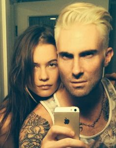 Adam Levine tries to prove that blondes have more fun?
