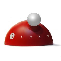 Tothora's award winning Dome table clock– inspired by the solar system and the movement of one body around another.  Available from www.clocksandchimes.co.uk