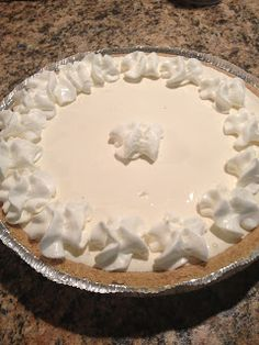 Frozen Lemonade Pie - 1 can sweetened condensed milk, 1 can frozen lemonade (lemon, lime or pink), 1 8 oz. cool whip, 1 graham cracker crust Mix first three ingredients, pour in pie shell, chill until firm, overnight is best. Garnish with whipped topping.