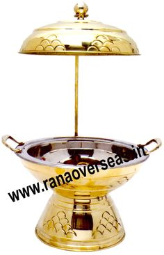 Brass Chafing Dish Brass Chafing Dishes are also ideal gift items. An extensive range of our Brass Chafing Dishes includes superior quality Decorative Brass Chafing Dishes that are fabricated from supreme quality metals. Our entire range of these Brass Chafing Dishes is praised by our clientele for its longevity, high durability, and modern designs. Mirror Finish, Corrosion resistant, Easy to clean and Perfect finish. Available Sizes :- 4 Litres, 6 Litres and 8 Litres.