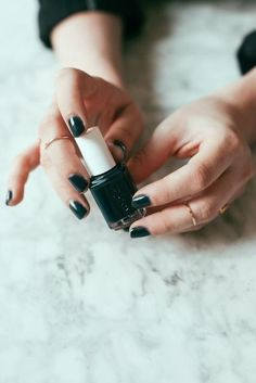 black mani + gold rings
