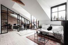 An Industrial Look For A Small Attic Apartment in Stockholm — THE NORDROOM New York vibes in a small Scandinavian attic apartment with exposed brick walls and industrial elements
