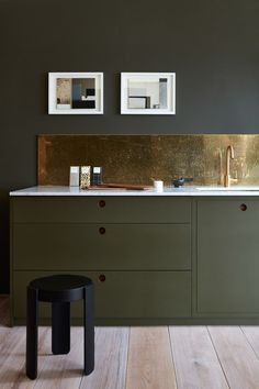kitchen in dark green... Brass splash back