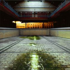"""Just like amusement parks, abandoned pools can portray a serene beauty. Gigi Cifali has captured some of the most incredible abandoned swimming pools in England. According to her website, """"in the Thirties United Kingdom…baths were at the peak of their popularity. Gradually tastes have changed, resulting in a drop in attendance, leaving the pools uneconomical to run."""" If there is one good thing that can be said about the closure of these pools, it is that it's allowed us the benefit of these…"""