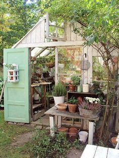 Garden shed built using repurposed vintage doors and windows! Garden shed built using repurposed vintage doors and windows! Bebe& Love this potting shed and potting bench outside the front door! Greenhouse Shed, Greenhouse Gardening, Simple Greenhouse, Greenhouse Wedding, Window Greenhouse, Portable Greenhouse, Balcony Gardening, Recycled Garden, Wooden Garden