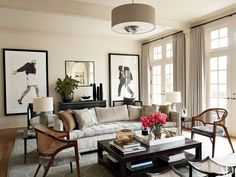 Melisse Shaban and Jane Elizabeth Phillips asked architect and designer S. Russell Groves to recast their Raleigh, North Carolina, house to suit their taste. In the living room, Robert Longo artworks overlook a sofa custom made by Donzella and vintage Y-back chairs upholstered in a Dedar velvet; the curtains are of a Lee Jofa wool, and the rug is by Mansour Modern.