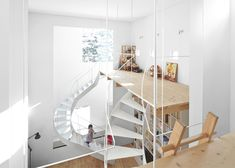 Hokkaido-based architect Jun Igarashi's (previously) latest home is perhaps as close to tree-house living as you'll find. Unless of course you live in an actual tree house. The multi-leveled home in Sapporo features a main living room with 23-ft high ceilings. Three different winding staircases acce