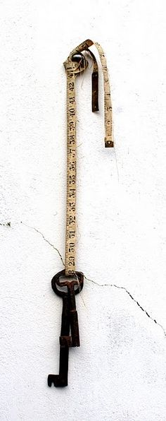 Love the measuring tape with the dangling key.    Marvelous overall shape and internal forms.