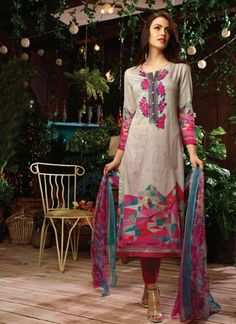 Make the heads turn the moment you dress up in this gorgeous multi colour cotton satin designer straight salwar kameez. The embroidered and print work appears to be chic and perfect for festival and party