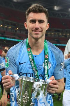 Aymeric Laporte of Manchester City celebrates with the trophy after winning the Carabao Cup Final between Chelsea and Manchester City at Wembley Stadium on February 2019 in London, England. Get premium, high resolution news photos at Getty Images Manchester City Logo, Manchester City Wallpaper, City Iphone Wallpaper, Mobile Wallpaper, Claudio Bravo, Zen, Kun Aguero, Kyle Walker, Fernando Torres