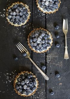 Rustic little blueberry pies.