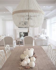 @jshomedesign- Ro Sham Beaux chandelier white beaded chandelier coastal style hamptons style trestle table restoration hardware neutral decor simply white benjamin moore