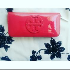 Auth Tory Burch Pink Logo Wallet Great Condition(small black scuffs on the front and really smalls one on the back)I tried my best to capture on the pics. This listing won't last long so if you're interested, grab it :) Tory Burch Accessories