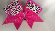Cheer Bow Pretty Little Base Pink Silver by BlingItOnCheerBowz This listing is for a new, handmade (by me) cheer bow. It is on a thick black hair tie and is a BIG bow made on 3 grosgrain ribbon. Measures about 7 1/2 inches across. Gorgeous!!! ALL my bows are shipped carefully in a