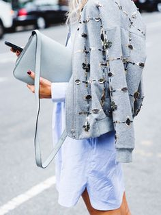 Shirt dress paired with an embellished bomber jacket draped over the shoulders