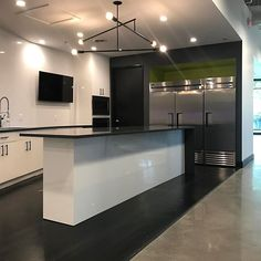 Clean and simple lines. Here is the new employee kitchen. #Birmingham #lajbuilding #udreamibuild #kitchen #kitchendesign #commercial #Quartz #waterfall #countertop