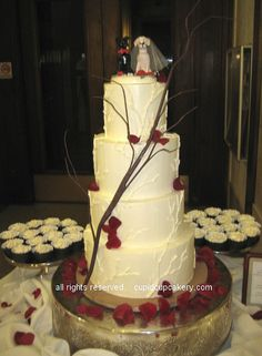 Tree Branch Wedding Cake by Cupid Cupcakery, via Flickr. 4 tier cake to serve 130.  Red Velvet cake filled with alternating layers of raspberry and cheesecake swiss meringue buttercreams.  Tree branch detail piped onto cake.  I made the actual tree branch looking decoration as well. Scattered red rose petals to match the table centerpieces.  30 vegan cupcakes in chocolate brown wrappers, vegan chocolate cupcakes with caramel frosting and vegan red velvet with cheesecake frosting.