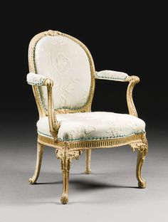 A GEORGE III GILTWOOD ARMCHAIR CIRCA 1770-5, ATTRIBUTED TO THOMAS CHIPPENDALE