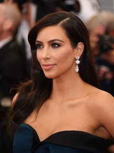 """Kim Kardashian attends the """"Charles James: Beyond Fashion"""" Costume Institute Gala at the Metropolitan Museum of Art on May 5, 2014. Old Hollywood glamour waves with a smoky eye and peach lip."""