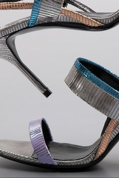 A multicolor metallic heeled sandal from Pierre Hardy, spring '21. #pierrehardy #sandals #fashion #womensshoes