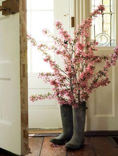 11 Spring Decorations for the Apartment - Floral arrangements are a terrific way to energize your interiors and add some wonderful scents. - Great idea with the rubber boots - or are they cowboy boots?
