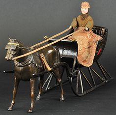 "Cutter Sleigh, Ives, circa 1893, only known example with original figure, Berry's favorite and rated by many as the zenith of toy artistry, ex-L.C. Hegarty and ex-Leon Perelman, 19½"" long, sold to a phone bidder at $234,000, dwarfing the $100,000/150,000 estimates."