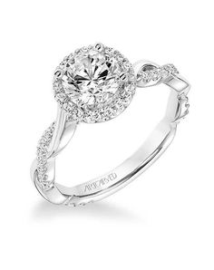 This engagement ring set was designed by Camellia Jewelry. This diamond engagement Ring is set with a round cut natural diamond set on the top of camellia flower . To achieve this stunning look, Weve created a matching diamond wedding band set in Wedding Rings Simple, Wedding Rings Vintage, Gold Wedding Rings, Bridal Rings, Diamond Wedding Bands, Unique Rings, Halo Diamond, Wedding Jewelry, Diamond Rings