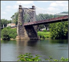 The historic suspension bridge in Wheeling, Ohio County, West Virginia. It has carried National Road traffic over the Ohio River since the 1850's. It is the oldest long span suspension bridge in the USA.