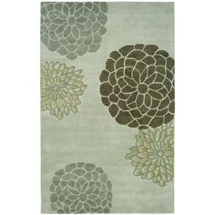 A modern design and dense, thick pile New Zealand wool highlight this handmade rug. This floor rug has a light grey background and displays stunning panel colors of brown, beige and grey.