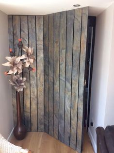 Burning forest slate veneer feature wall panels with hidden door