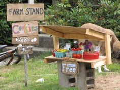 the farm stand full of produce and decked with signs