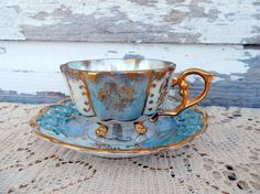 I found 'Hand painted Footed Tea Cup Teacup  Saucer Powder Blue pearl and gold small size' on Wish, check it out!