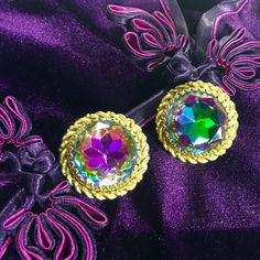 "Authentic Elsa Schiaparelli Earrings Signed Schiaparelli earrings from the 1950's. Fantastic vintage watermelon rainbow crystal shows the light spectrum along with more prominent violets, pinks, green and gold light. Set in a beautiful gold tone bezel. Measures 1.25"" in diameter✨ These earrings are quite nicely preserved. There is gentle wear to the backs. See photos. Very comfy to wear! Price Firm. Discounted in a Bundle. Vintage Jewelry Earrings"
