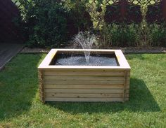 Raised square wooden fish pond