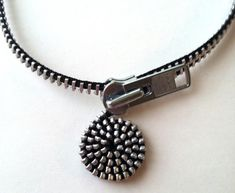 Artologie's Signature Design~a showstopper! Always gets a second look. Wear a unique work of art! Spiral-sculpted necklace made from new large-toothed black zipper. Choker style, looks great on both men and women. Easy-to-use, over-sized lobster claw clasp. Available in 2 sizes: 17.5 inches 19.5 inches Please specify when ordering. Artologie reserves the right to copyright protection under applicable law.