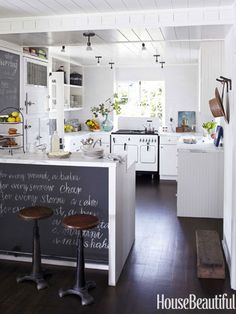 LOVE the chalk board & white w/ wood flooring